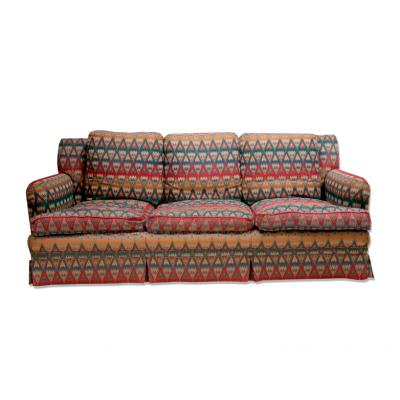 Duża trzyosobowa kanapa tapicerowana gobelinową tkaniną we wielokolorowy wzór. XX w.
