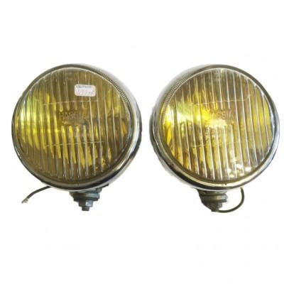 Para dużych, żółtych reflektorów marki HASSIA używanych przez markę Volkswagen. Niemcy, poł. XX wieku.